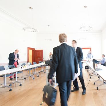 Meeting bei dem die Zusammenarbeit im Führungsteam optimiert werden soll