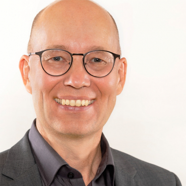 Holger Schlichting, Senior Berater und Geschäftsführer der PRAXISFELD GmbH